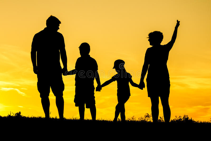 Happy family silhouette royalty free stock photography