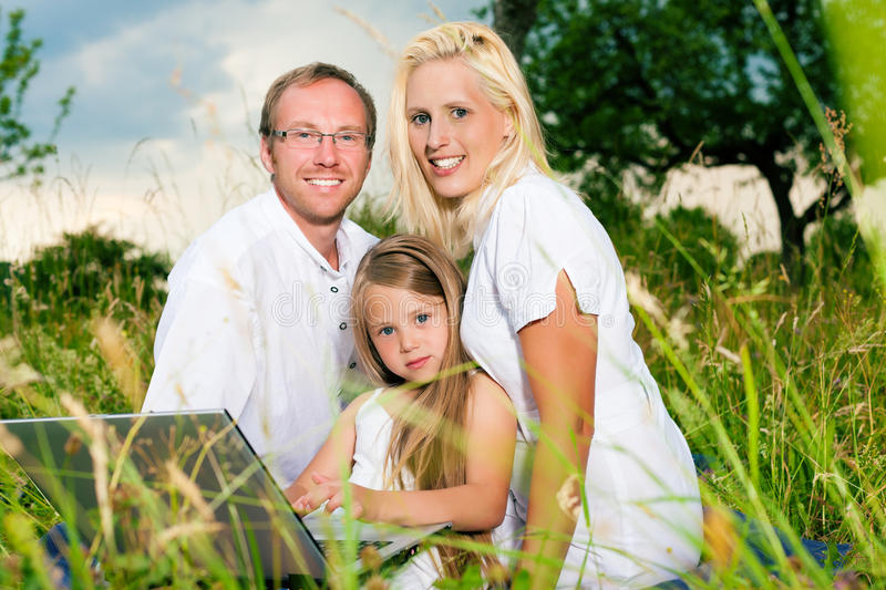 Download Happy Family Sitting In Meadow Stock Image - Image: 20883499