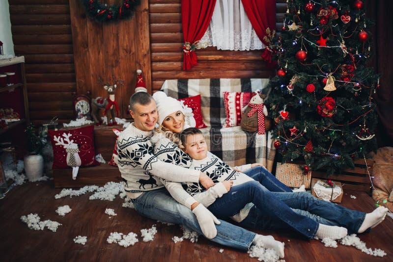 Happy Family Sitting Near Christmas Tree stock image