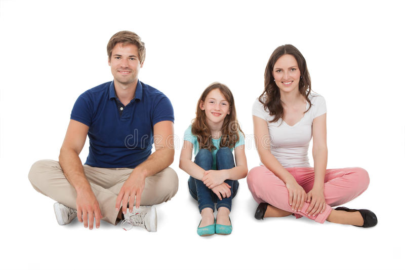 Happy family sitting over white background royalty free stock images