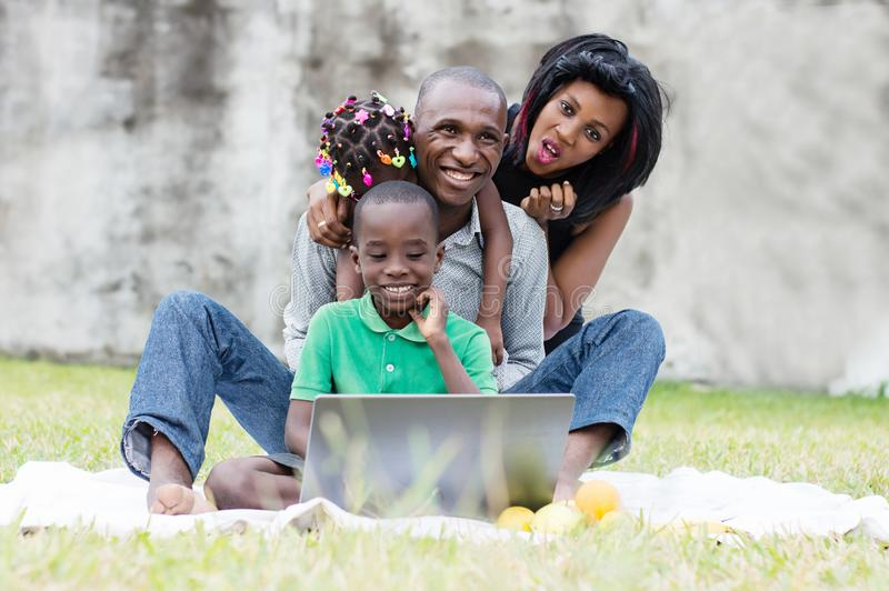 Happy family playing at the park stock photography