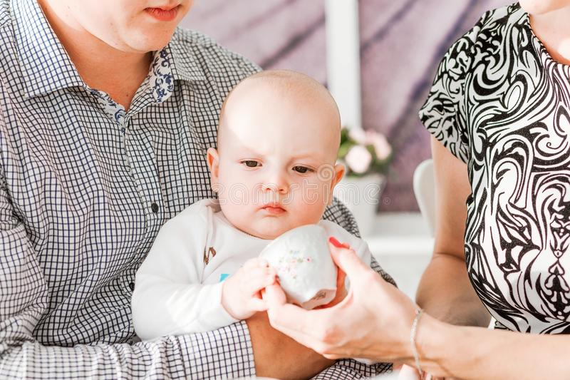 Happy family sitting with their little son at the table. Photo of happy family sitting with their little son at the table stock photography