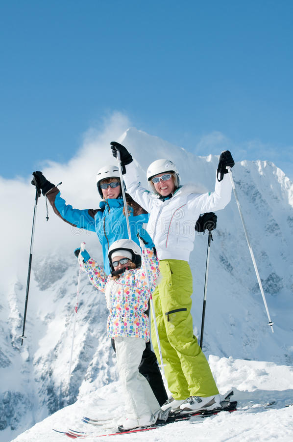 Happy family on ski. Happy mother with daughters on ski