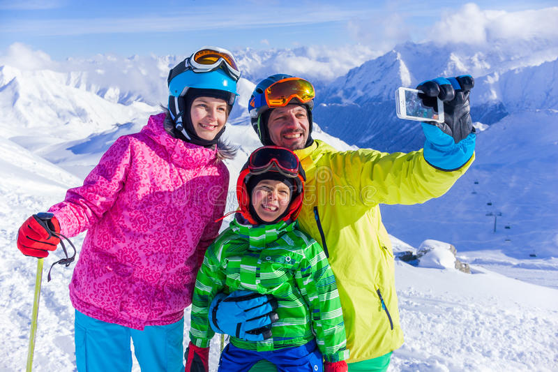 Happy family on ski royalty free stock images