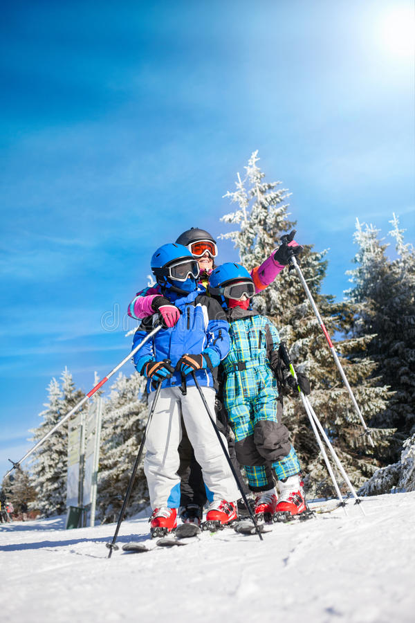 Happy family ski team fun on beautiful mountain royalty free stock photography