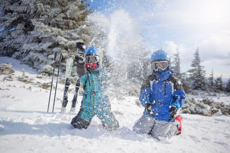 Happy family ski team fun on beautiful mountain royalty free stock photos