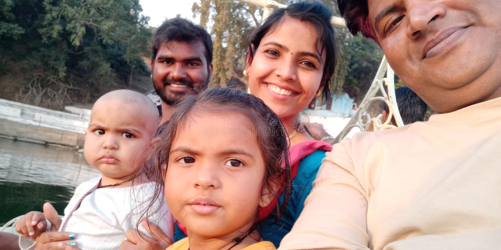 Happy family with smile of india. Street port-rate,family on street, use for backgrounds, paintings, book covers for history etc stock image