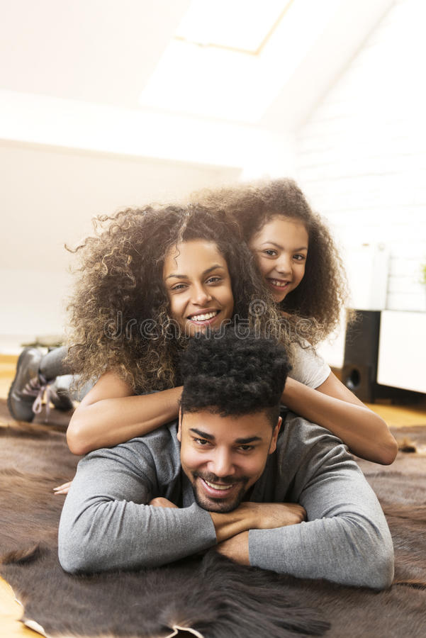 Happy family smiling and enjoying together stock photo