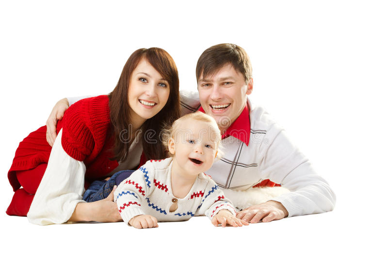 Happy family, smiling father mother and laughing baby. Happy family three persons, smiling father mother and laughting baby lying over white background royalty free stock photo
