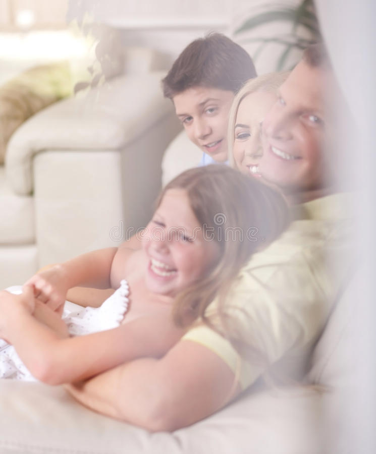Happy family smiling and looking royalty free stock photo
