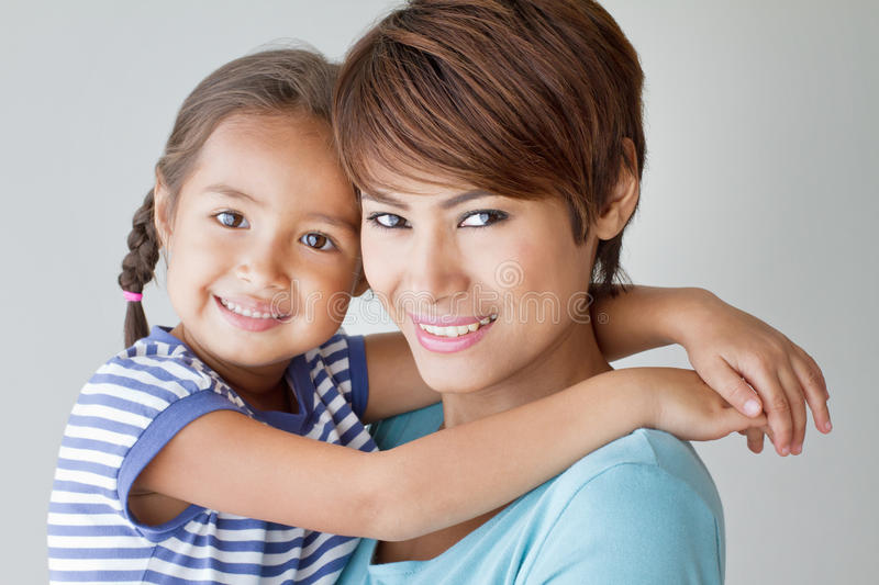 Happy family with smiling, positive daughter and mother royalty free stock images