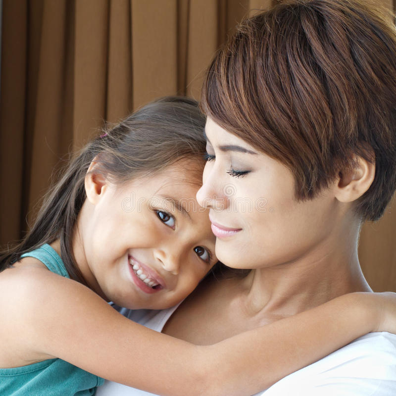 happy family with smiling, positive, lovely daughter and mother stock photos