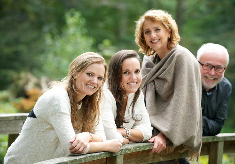 Download Happy Family Smiling Together Outdoors Stock Photo - Image: 34058424