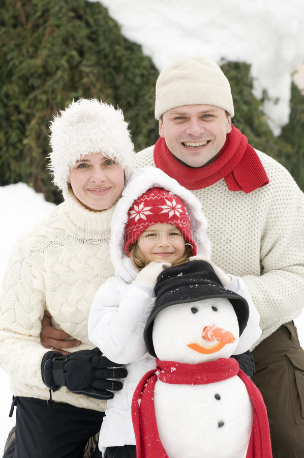 Download Happy family with snowman stock image. Image of posing - 16214415