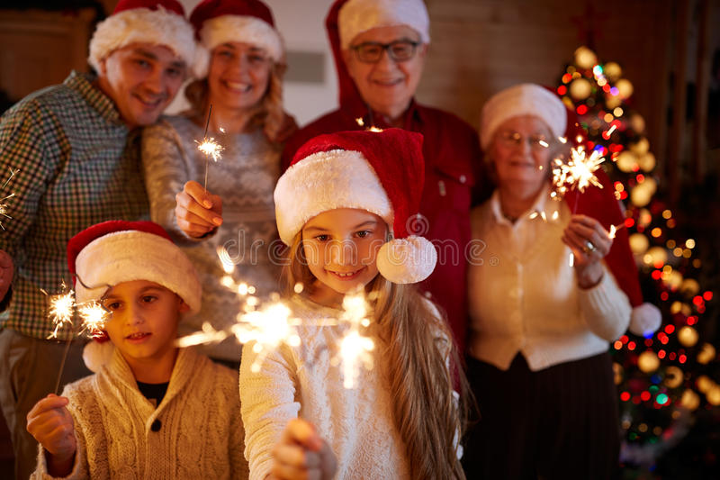 Happy family with sparklers celebrate Christmas royalty free stock photos