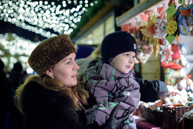 Download Happy Family Spend Time At A Christmas Street Market Fair In The Stock Image - Image: 83705673