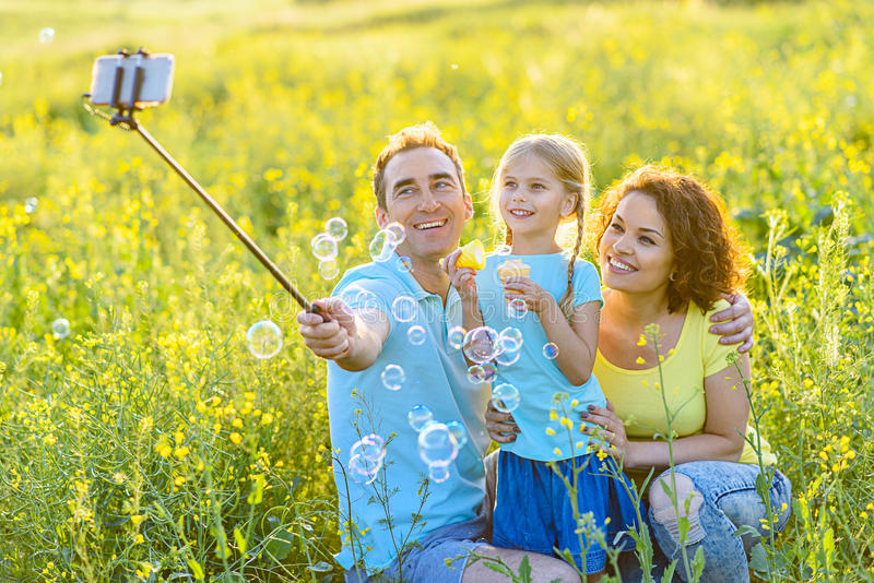 Happy family spending weekend outdoors stock photography