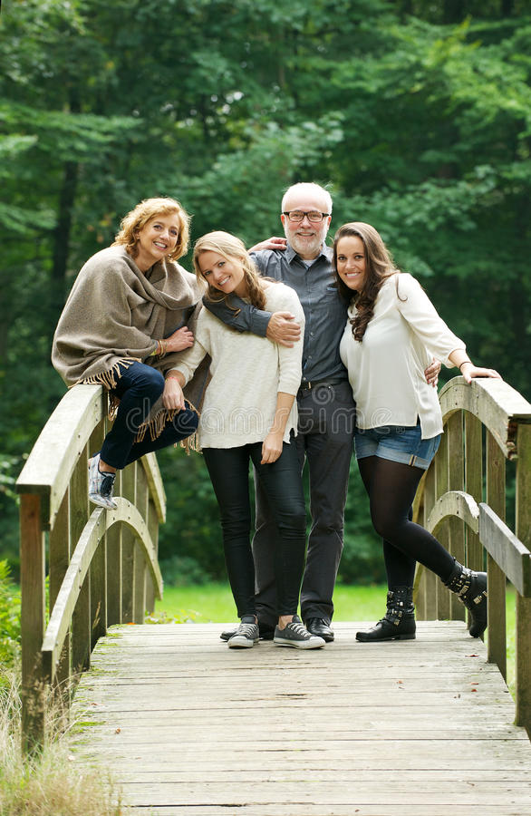 Download Happy Family Standing Together On A Bridge In The Forest Royalty Free Stock Image - Image: 34058416