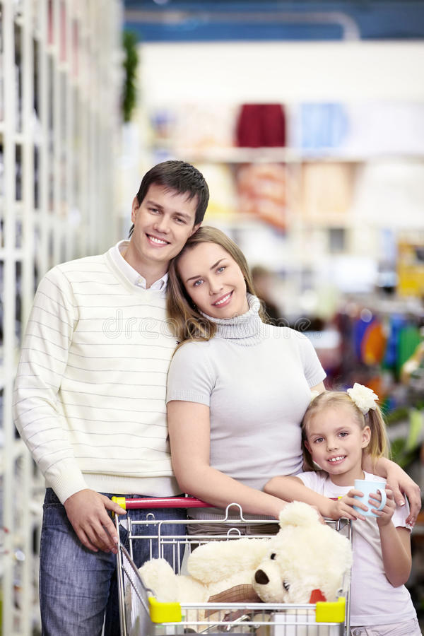 Happy family in the store royalty free stock image