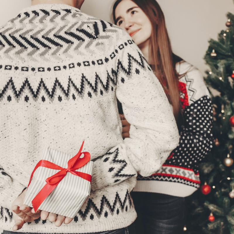 Happy family in stylish sweaters exchanging gifts in festive room with christmas tree and lights. emotional moments. merry christ. Mas and happy new year concept royalty free stock photos