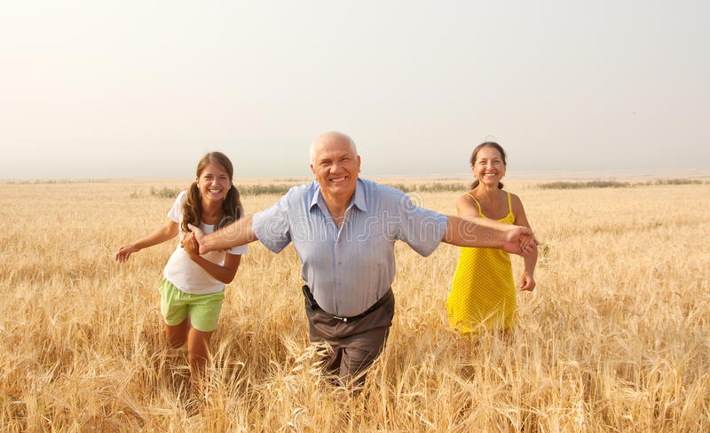 Happy family on summer countryside
