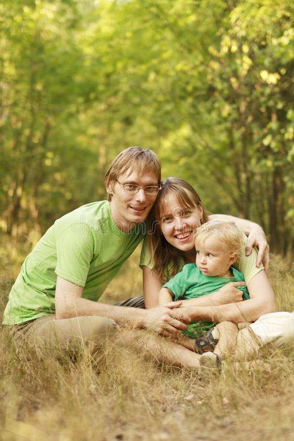 Happy family in summer forest stock photo