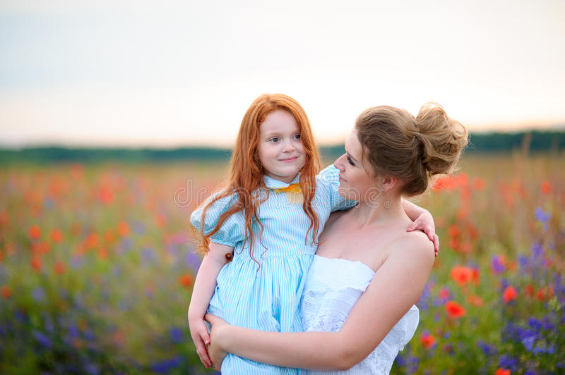 Happy family on a summer meadow. little girl child baby daughter stock image