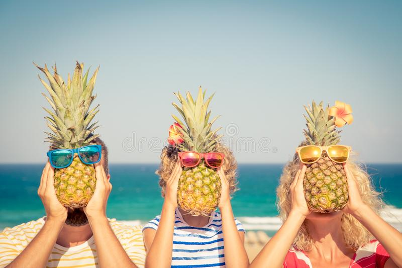 Happy family on summer vacation. People having fun on the beach. Healthy eating lifestyle stock images