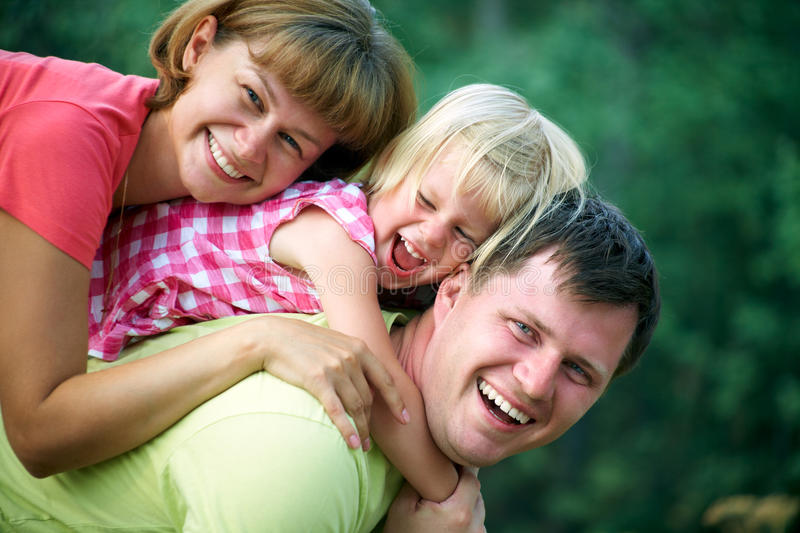 Happy family in summertime stock photo