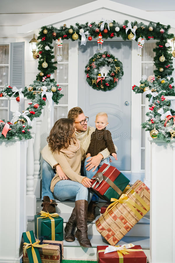 Happy family, surrounded with Christmas gifts stock photos
