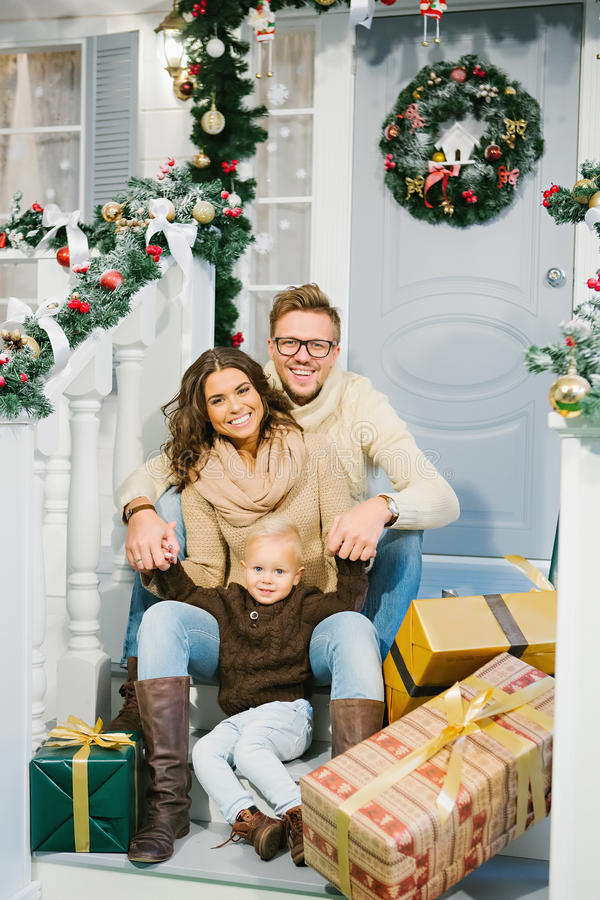 Happy family, surrounded with Christmas gifts royalty free stock photo