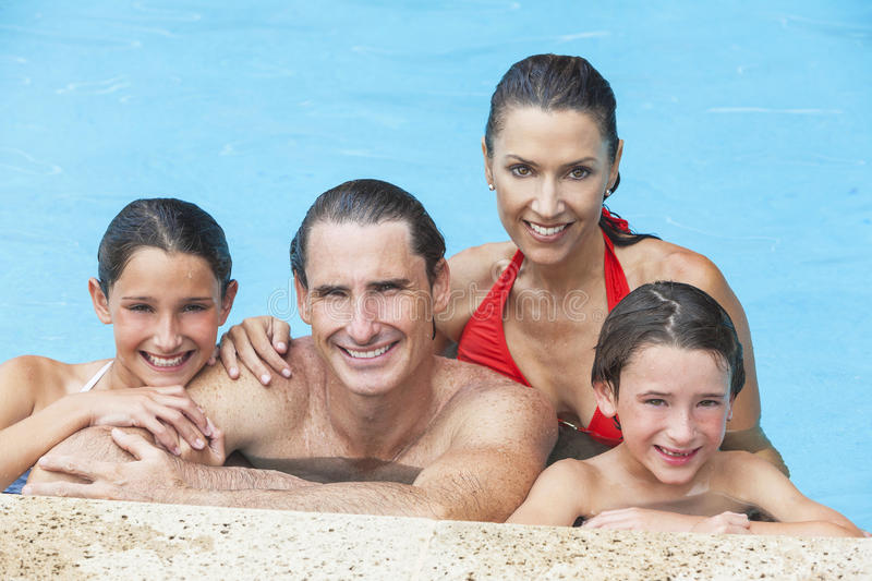 Happy Family In Swimming Pool Royalty Free Stock Photo