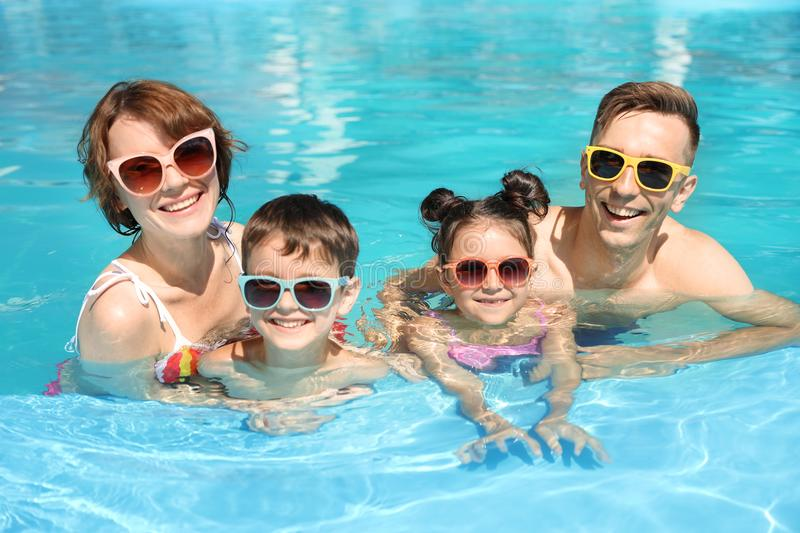 Happy family in swimming pool. At resort royalty free stock images