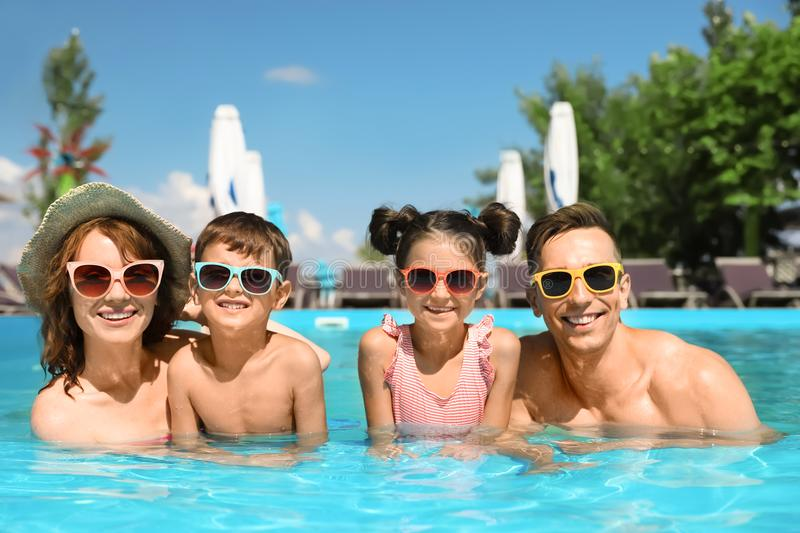 Happy family in swimming pool. At resort royalty free stock photography