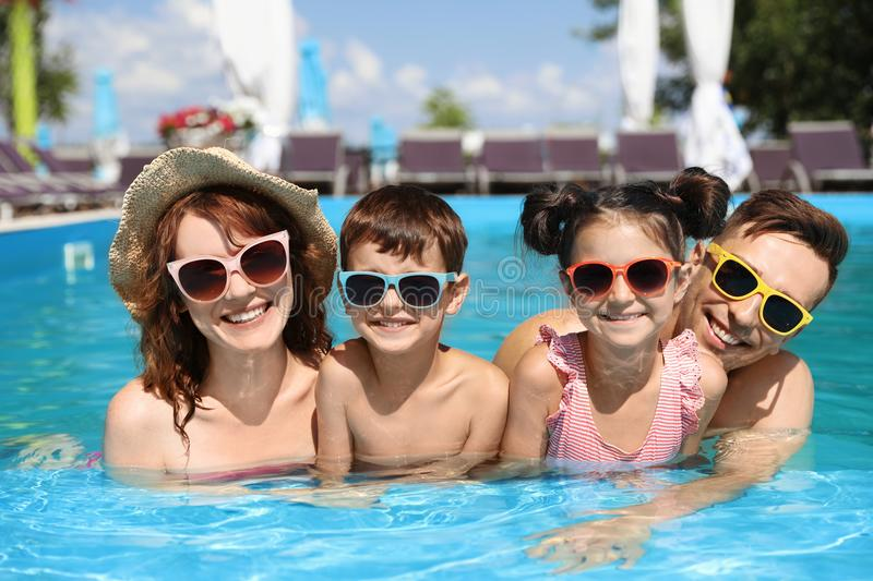 Happy family in swimming pool. At resort stock photography