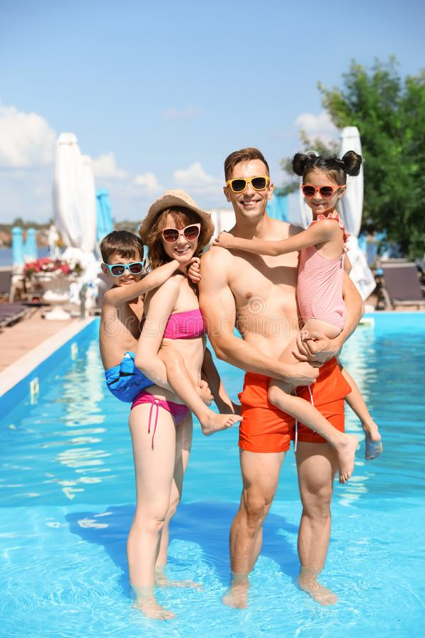 Happy family in swimming pool. At resort royalty free stock photos