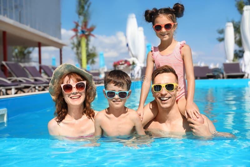 Happy family in swimming pool. At resort stock photo