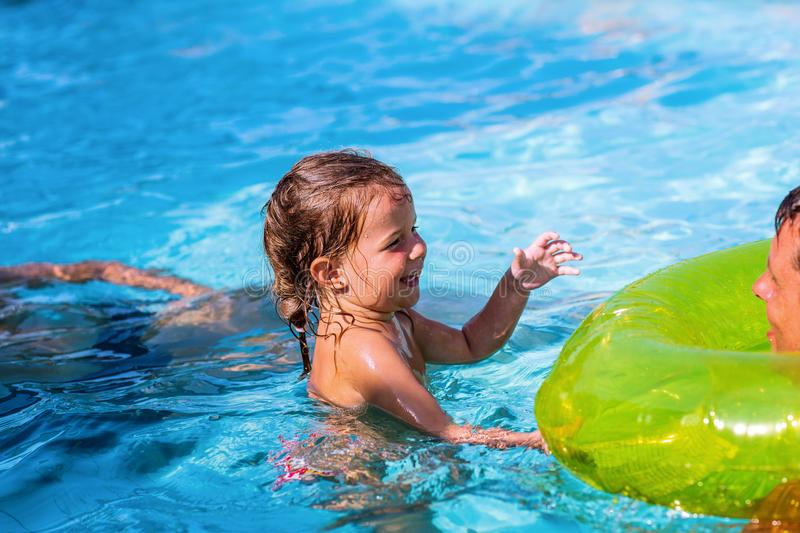 Happy family in swimming pool. Summer vacation stock photos