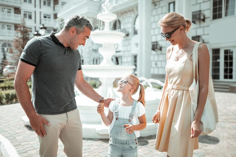 Happy family taking a morning stroll together. stock photography