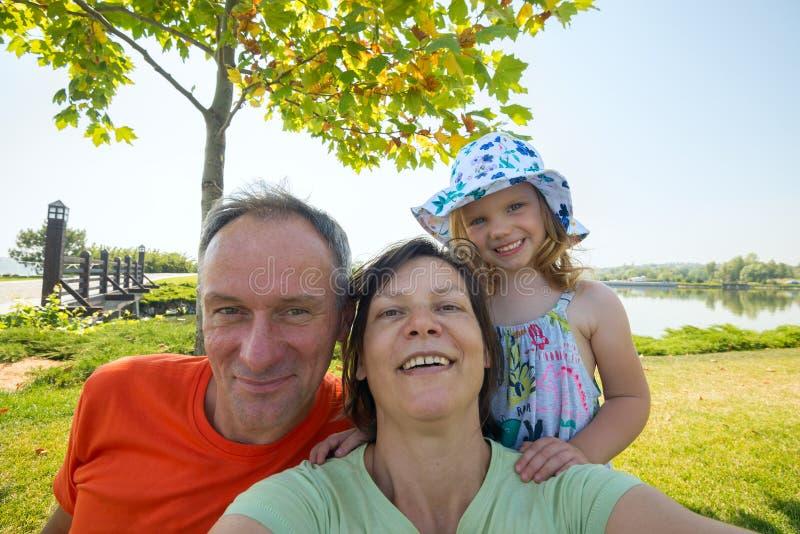 Happy family taking selfie royalty free stock photo