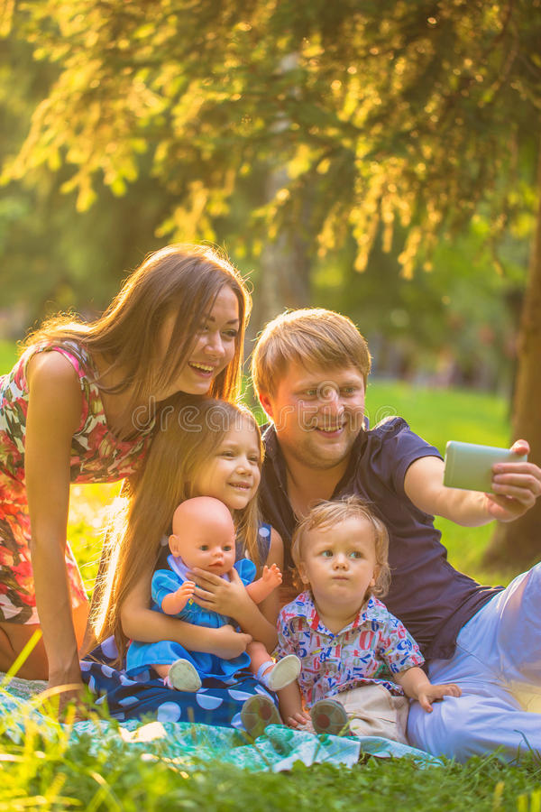 Happy family taking selfie in park. stock images