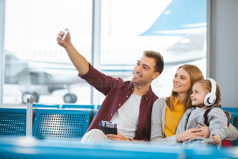 Happy family taking selfie and smiling royalty free stock photo