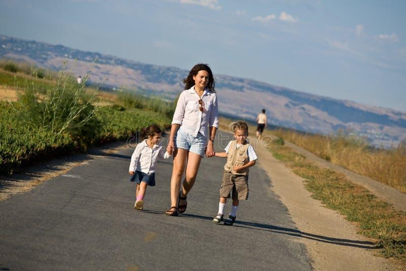Happy family taking a walk royalty free stock photography