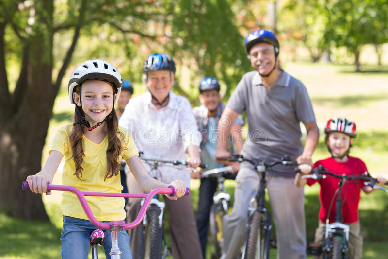 Happy family on their bike at the park stock image