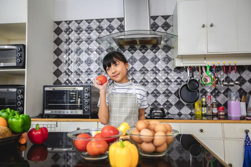 Happy Family  and their little daughter Cooking Together in the Kitchen royalty free stock photo