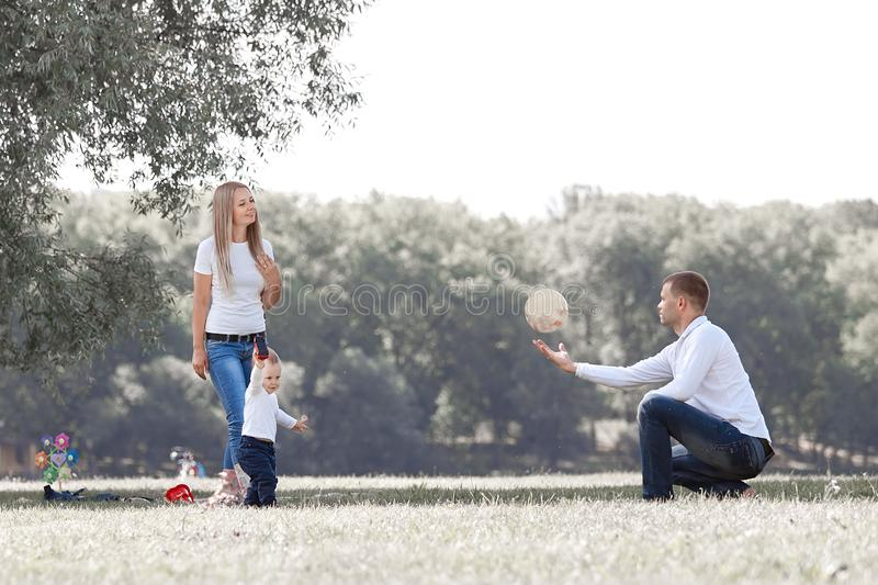 Happy family with their little son on a walk in the city Park. stock photos
