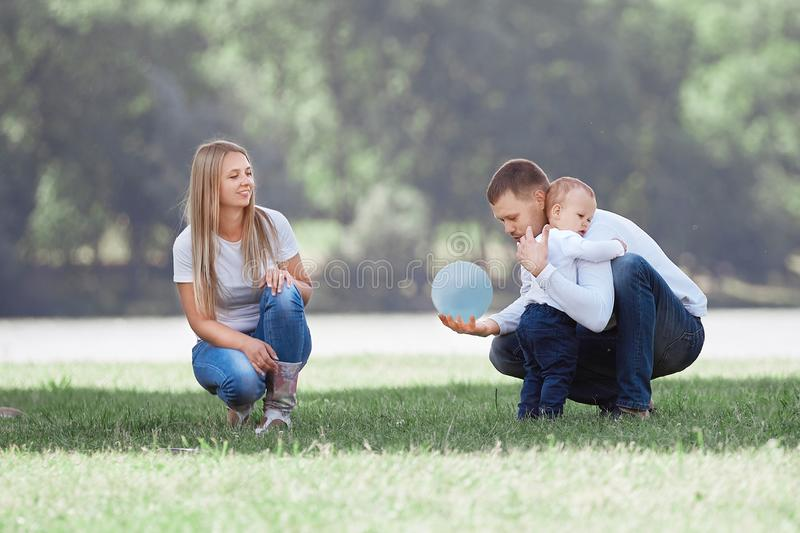 Happy family with their young son spend their time in the city Park. royalty free stock images