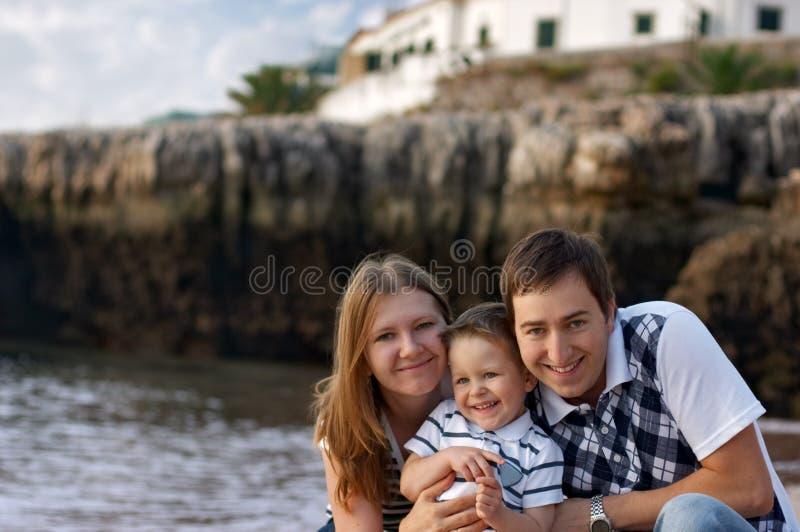 Happy family of three. Having fun outdoors royalty free stock photo