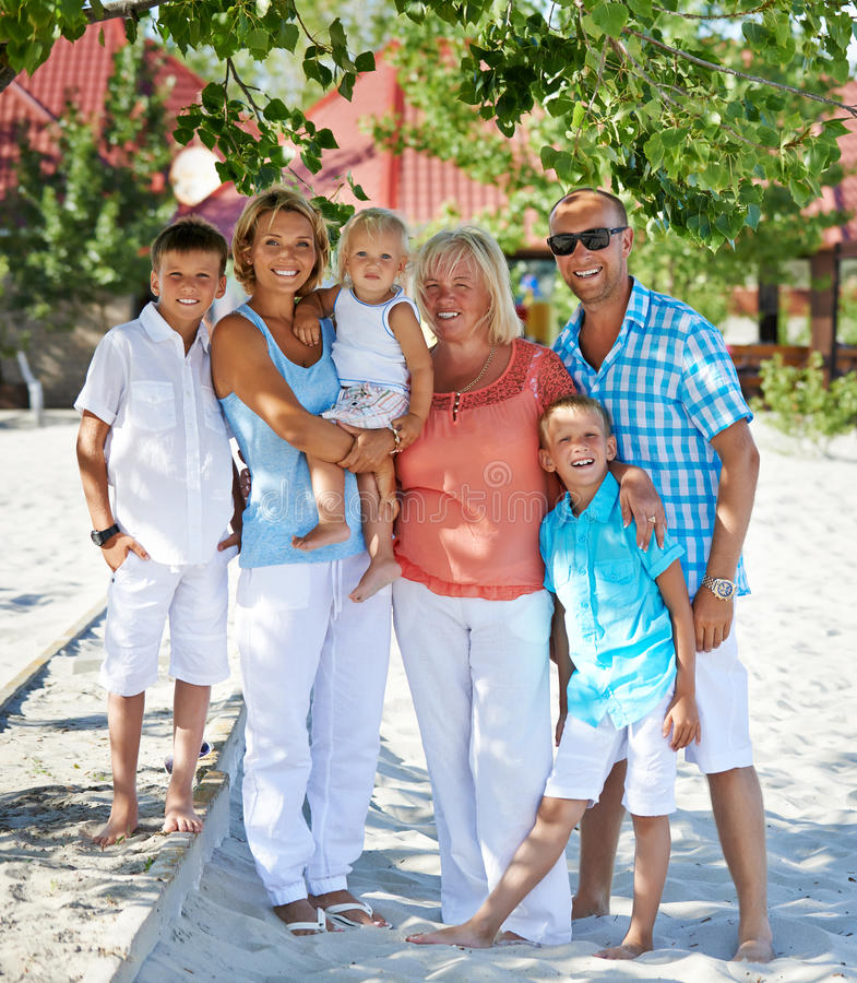 Happy family with three children standing together. stock image