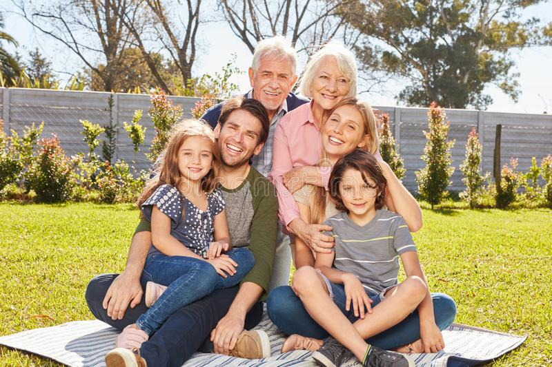 Happy family with three generations in the garden royalty free stock photo